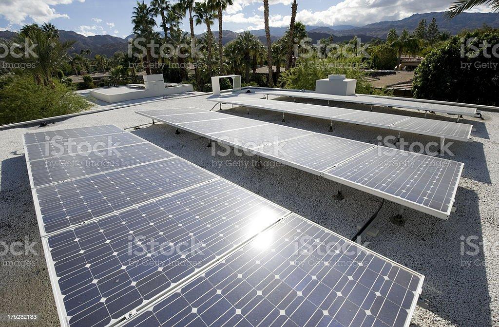 solar panels soaking up sunlight stock photo