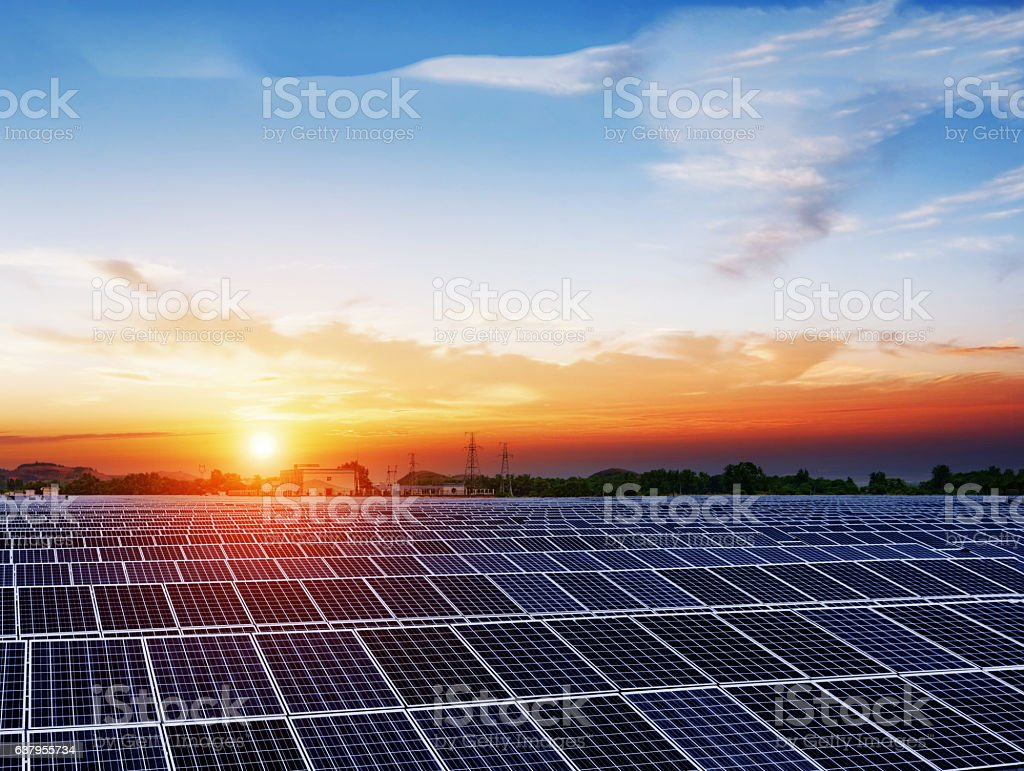 solar panels  under blue sky on sunset stock photo