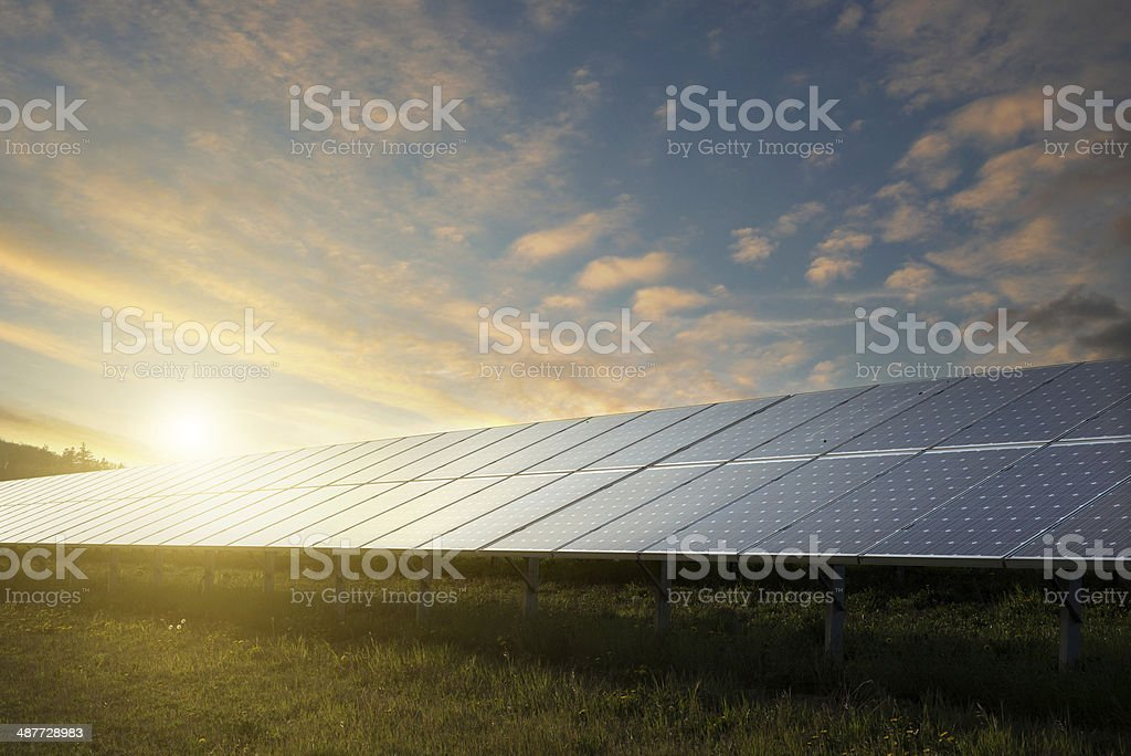 solar panels under sky on sunset stock photo