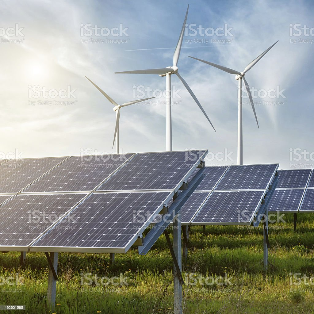 solar panels under sky stock photo