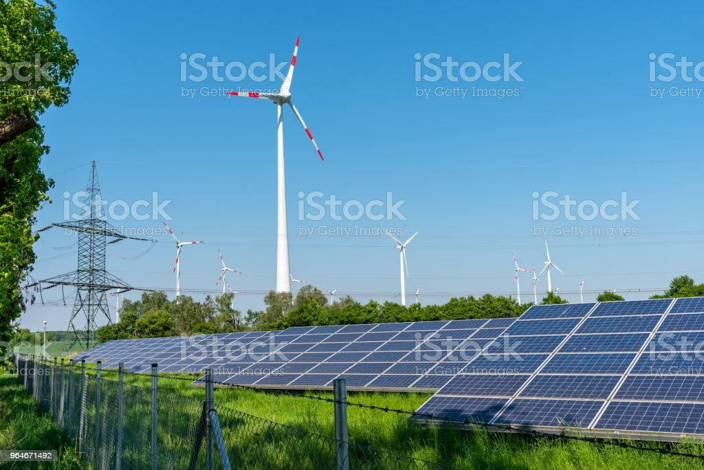 Solar panels, wind engines and an electricity pylon royalty-free stock photo