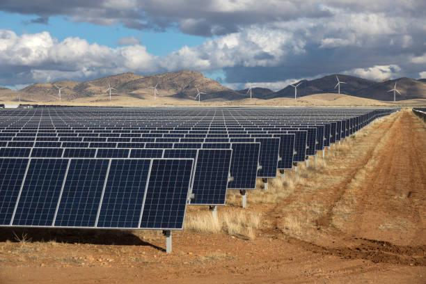 Solar panels wind farm turbines Wilcox Arizona Sonoran Desert Mountains stock photo