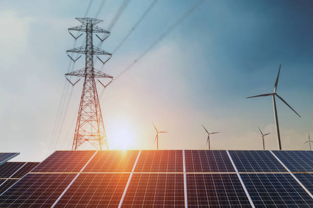 Solar panels with electricity pylon and wind turbine Clean power energy concept. sunset background Solar panels with electricity pylon and wind turbine Clean power energy concept. sunset background electricity pylon stock pictures, royalty-free photos & images