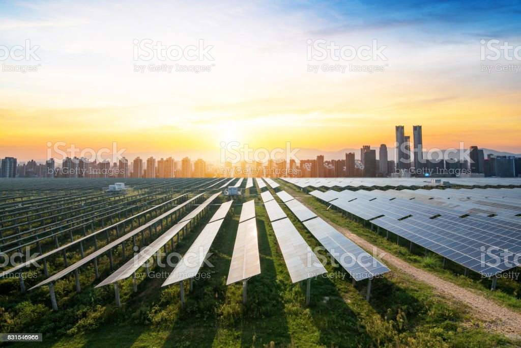 solar panels with the sunny sky. Blue solar panels. background of photovoltaic modules for renewable energy. stock photo