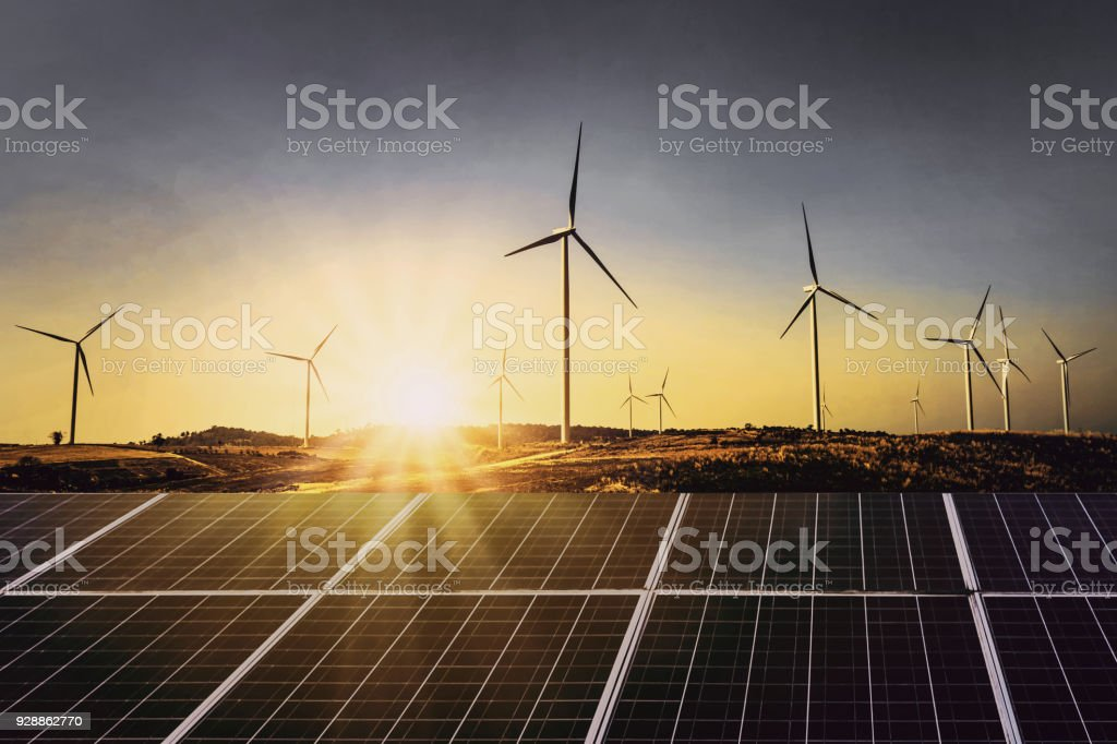 solar panels with wind turbine and sunset .concept power energy in nature royalty-free stock photo