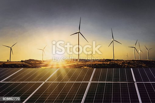 istock solar panels with wind turbine and sunset .concept power energy in nature 928862770