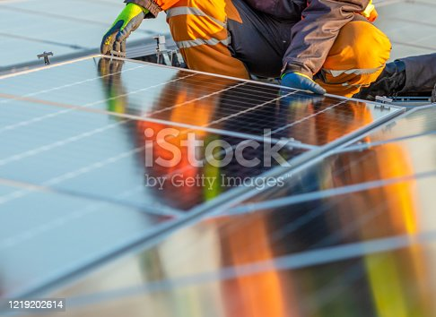 Solar panels installation on rooftop, ideal for any renewable article or wallpaper