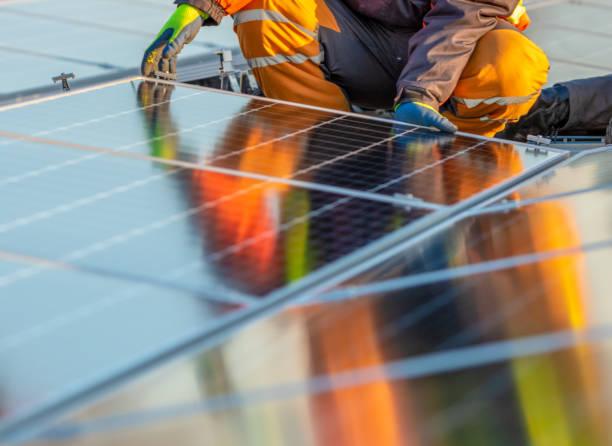 solar photovoltaic modules on a rooftop - solar panel imagens e fotografias de stock