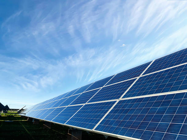 solar plant(solar cell) with the cloud on sky, hot climate causes increased power production, alternative energy to conserve the world's energy, photovoltaic module idea for clean energy production - solar panel imagens e fotografias de stock