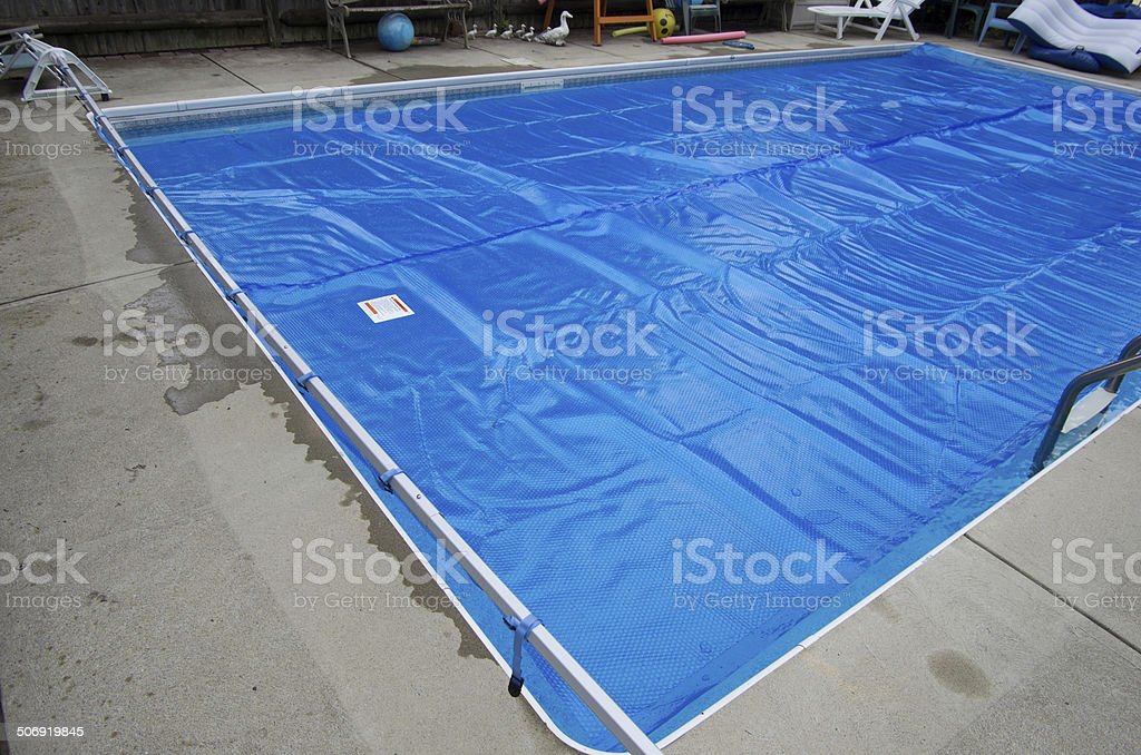 Solar pool cover on swimming pool stock photo