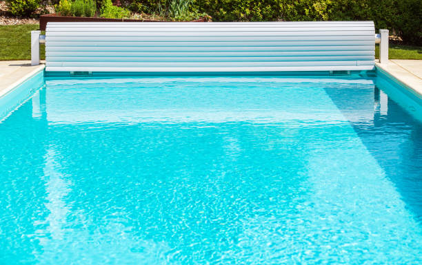 Solar Pool Cover Roller Shutter With Crank stock photo