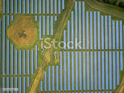 Aerial view of the solar power farm - a large scale photovoltaic system designed for the supply of merchant power into the electricity grid.