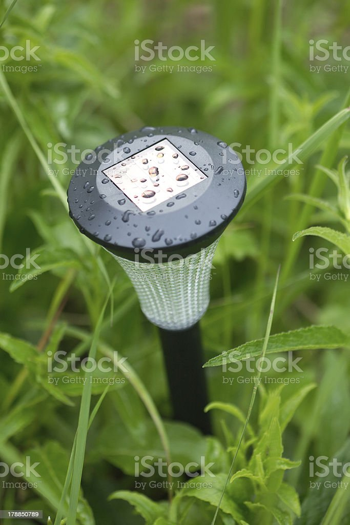 Solar power lantern outdoor in grass closeup royalty-free stock photo