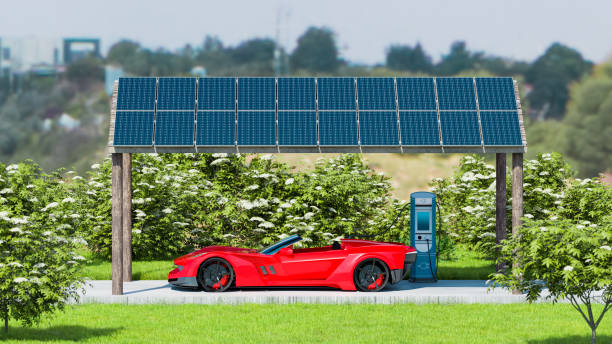 Solar power panels charges electric car parked outside stock photo