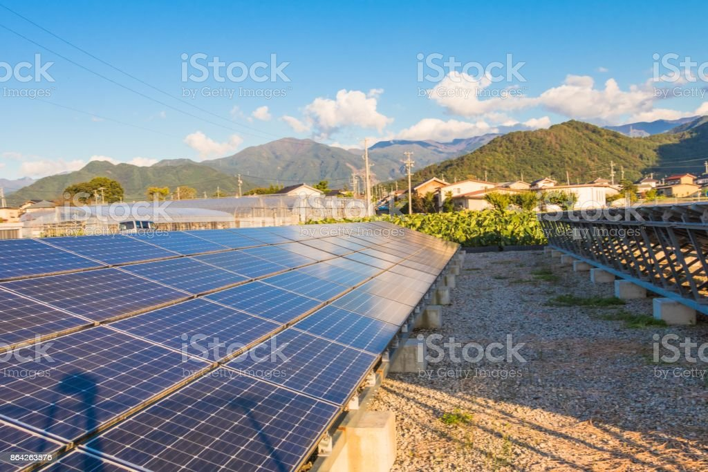 Solar power panels ,Photovoltaic modules for innovation green energy for life with blue sky background. royalty-free stock photo
