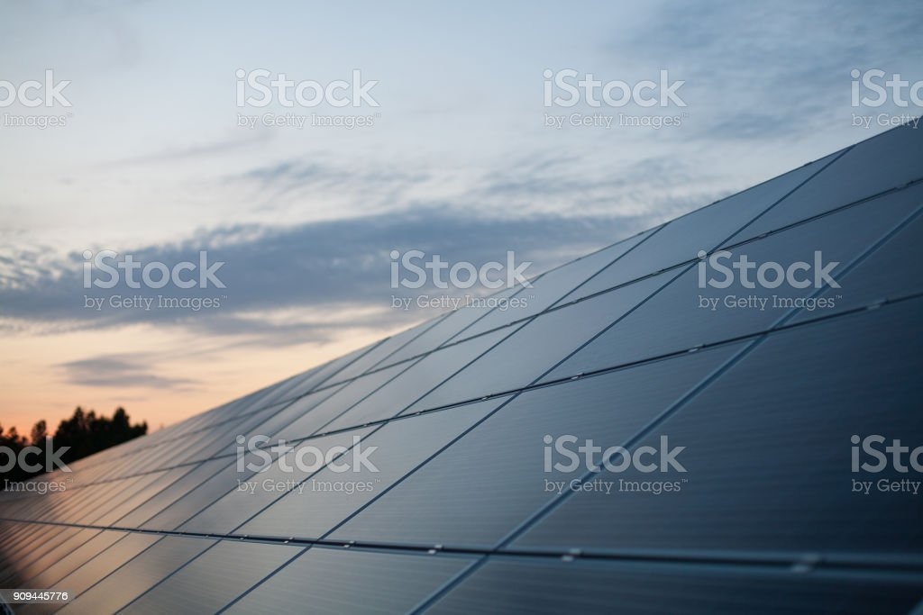 Solar power plant at sunset stock photo