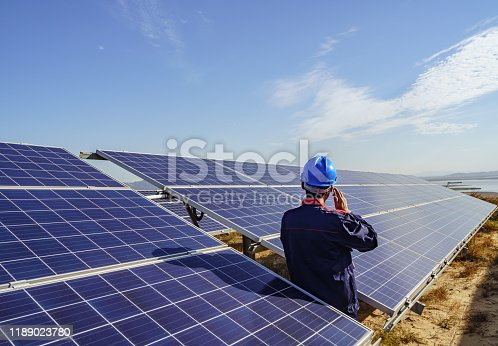 Solar power plant engineer is checking