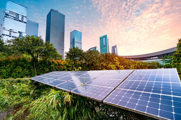 Solar Power Plant in modern city,Sustainable Renewable Energy stock photo