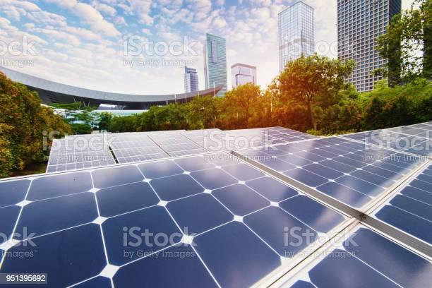 Solar power plant in modern citysustainable renewable energy picture id951395692?b=1&k=6&m=951395692&s=612x612&h=rtw9uua4ybmsezdp 4drt5fsmk6w7ows jka2xuavru=
