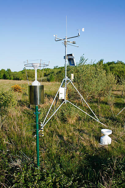 solar power weather station - rain gauge stock photos and pictures