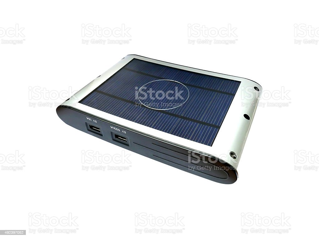 Solar powered external battery charger isolated on white stock photo