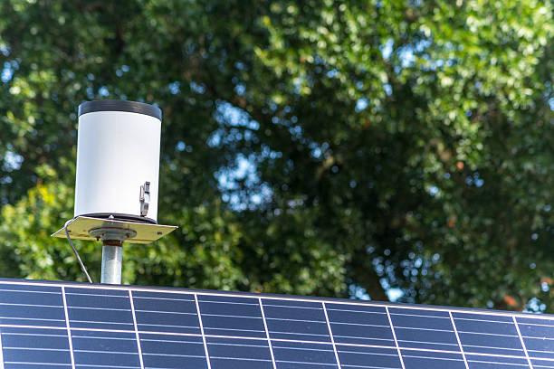 solar powered rain gauge - rain gauge stock photos and pictures