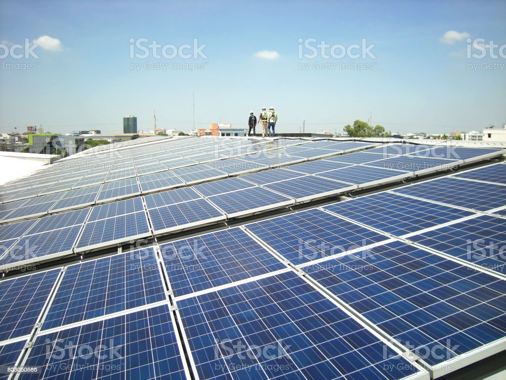 Solar PV Rooftop with Workers Walking royalty-free stock photo