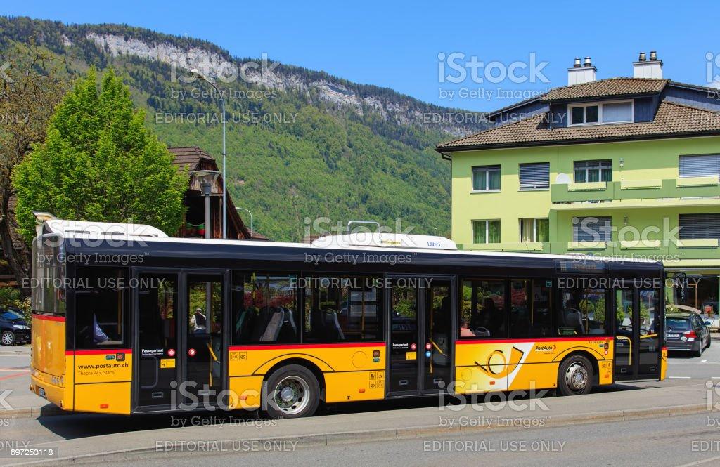 Solaris Urbino 12 bus of the PostAuto company in Switzerland stock photo