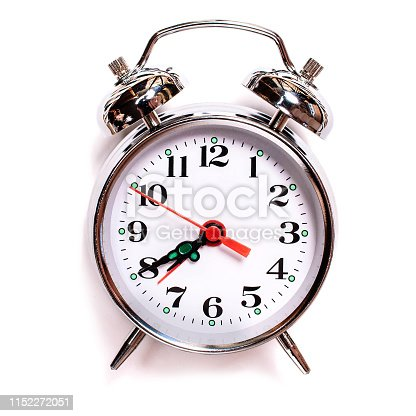 istock solated vintage analog alarm clock on a white background. Seven forty am on alarm clock 1152272051