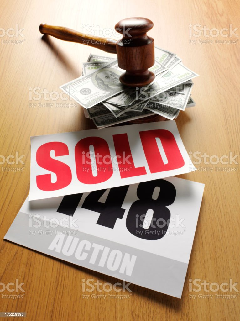 Sold at Auction Sign with 100 Dollar Banknotes stock photo