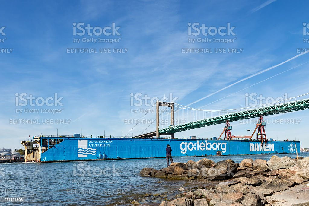 Sold dry dock leaves Gothenburg after long service. stock photo