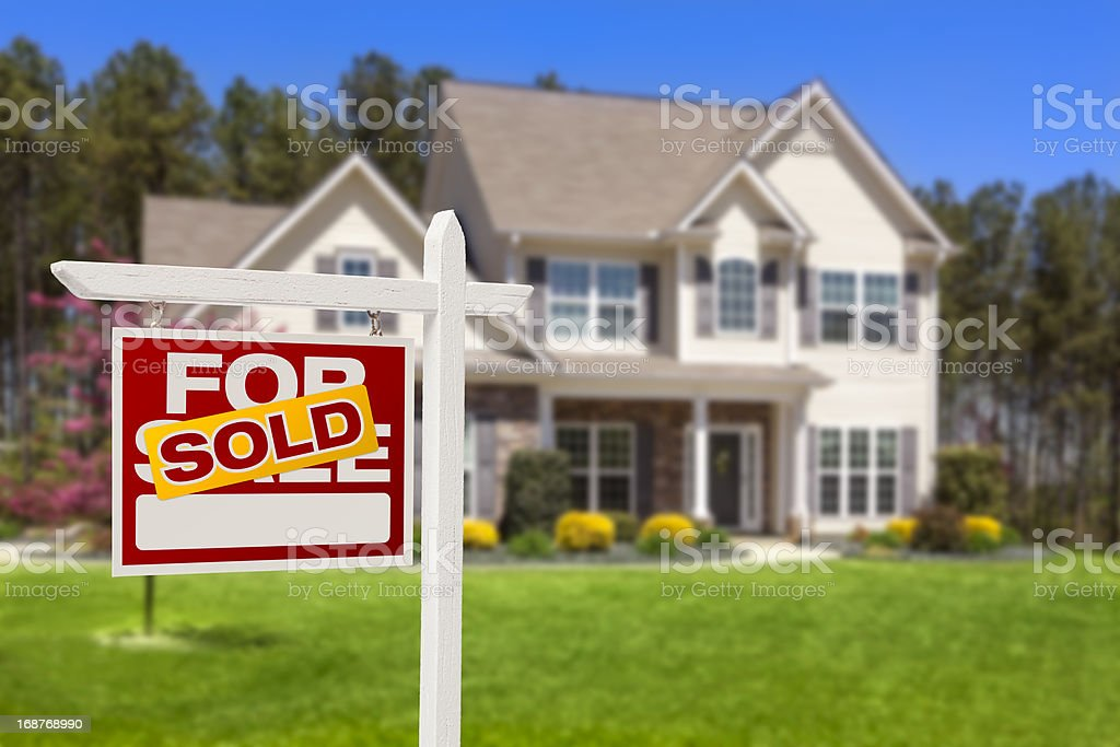 Sold Home For Sale Real Estate Sign and House stock photo