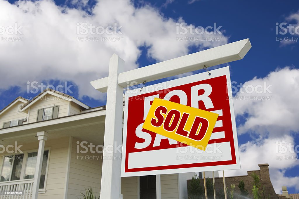 Sold Home For Sale Sign in Front of New House royalty-free stock photo
