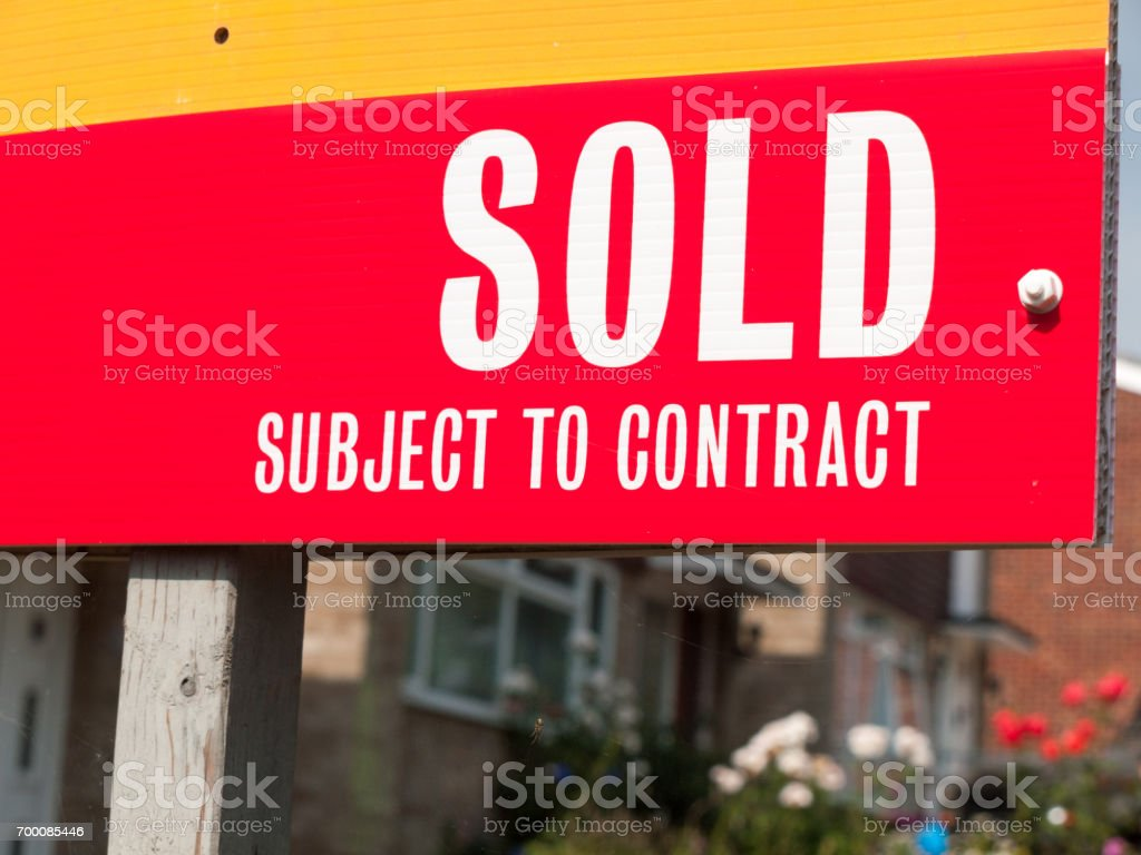 sold house sign up close stock photo