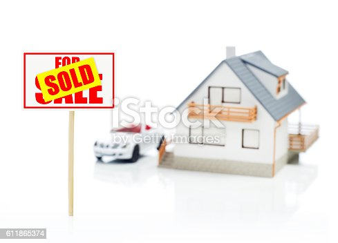 istock Sold sign and model house 611865374