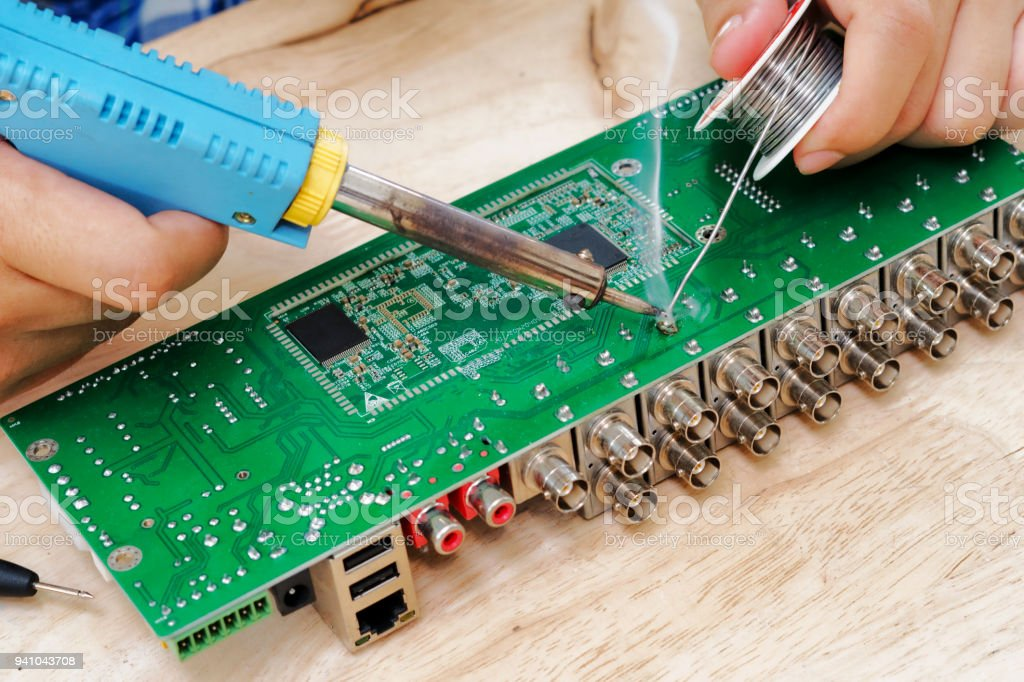soldering an electronic circuit board stock photo more pictures of rh istockphoto com