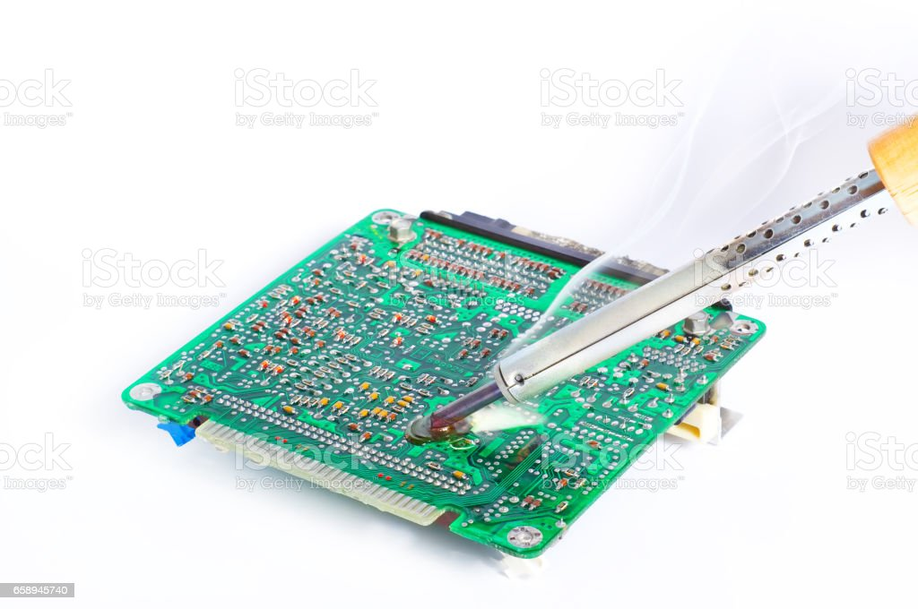 Soldering and repair of the electronic engine control unit stock photo