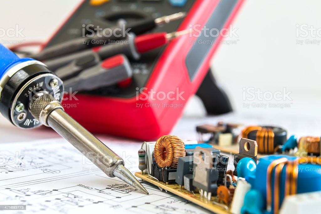 soldering iron and 12V pulse source royalty-free stock photo