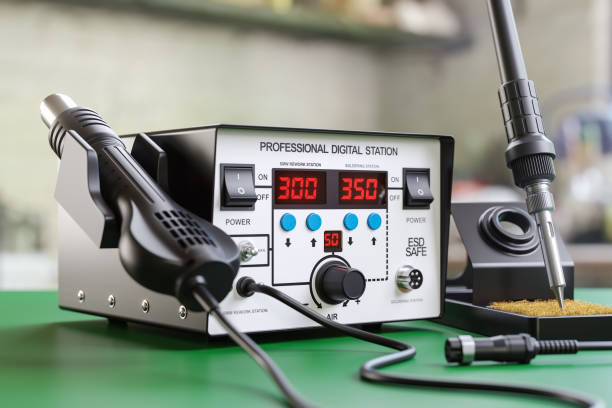 Soldering iron digital station on the workplace Soldering iron digital station on the workplace. 3d render illustration soldering iron stock pictures, royalty-free photos & images