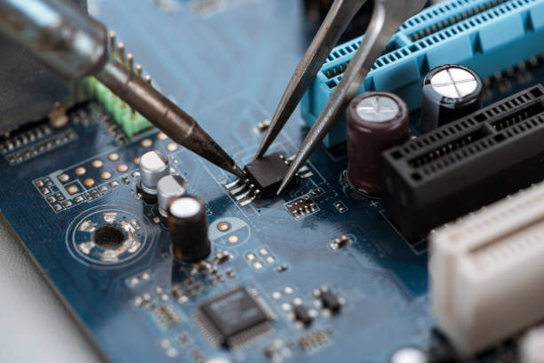 Soldering typical desktop computer baseboard close-up view stock photo