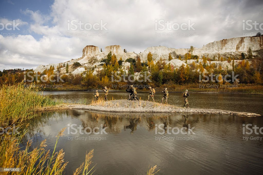 Solders squad transports hostage to the point of evacuation stock photo