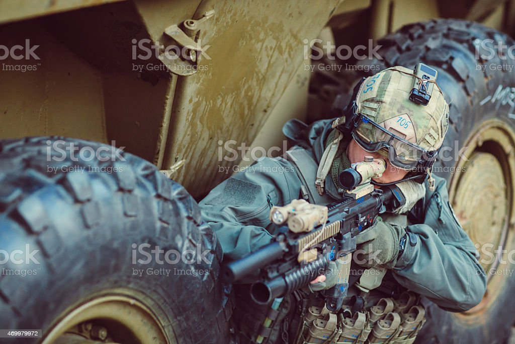 Soldier aim at a target of weapons stock photo