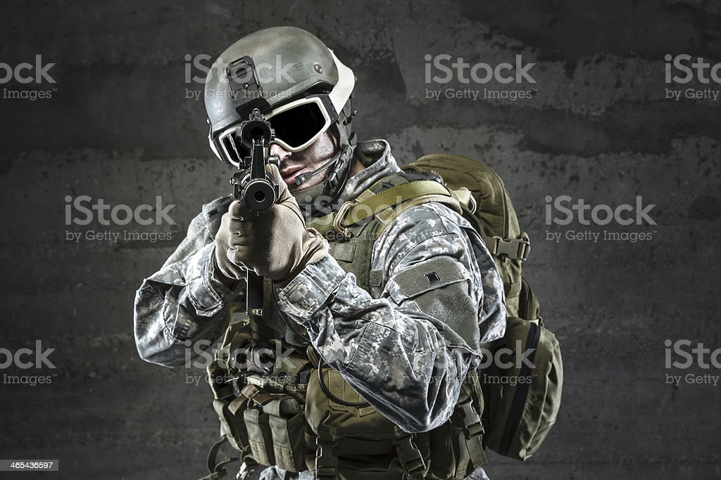 Soldier aiming a rifle at you stock photo