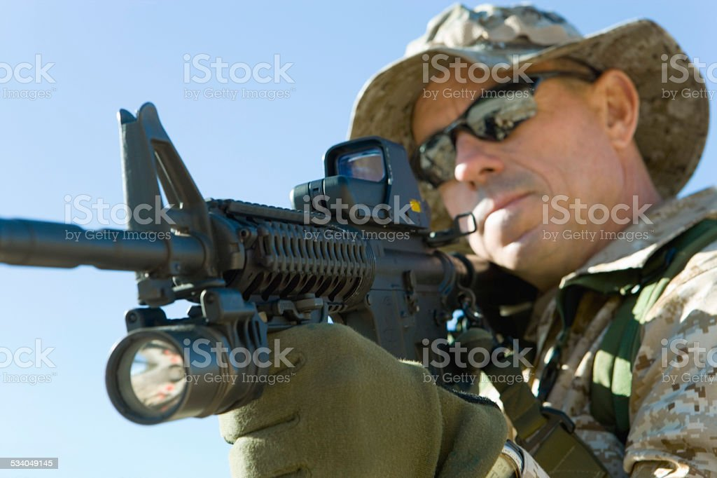 Soldier Aiming Rifle stock photo