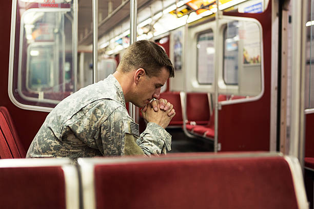 Soldier alone in train Depressed soldier on the train post traumatic stress disorder stock pictures, royalty-free photos & images