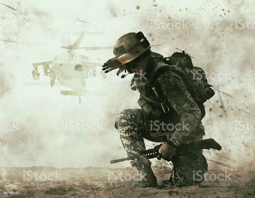 US soldier and combat helicopter approaching stock photo