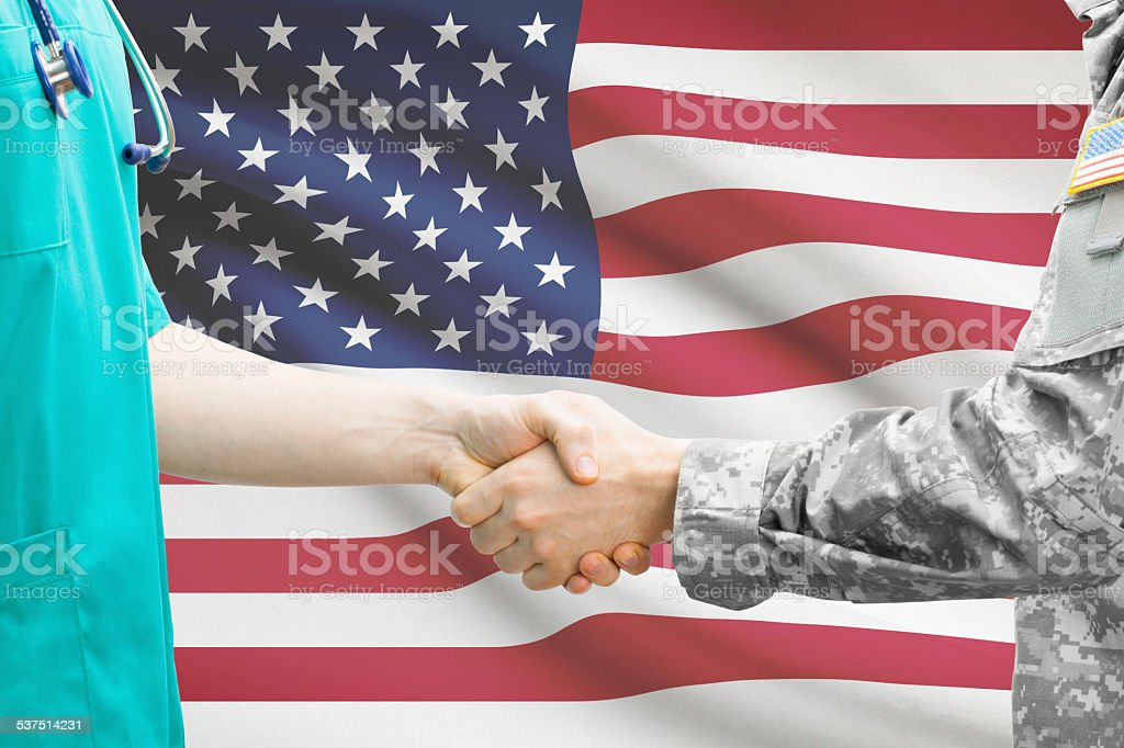 Soldier and doctor. Flag on background - United States stock photo