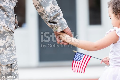 istock Soldier and his daughter walk hand in hand 941439768