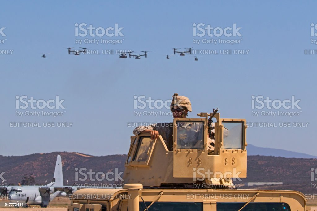 Soldier and squadron of helicopters flying at air show stock photo