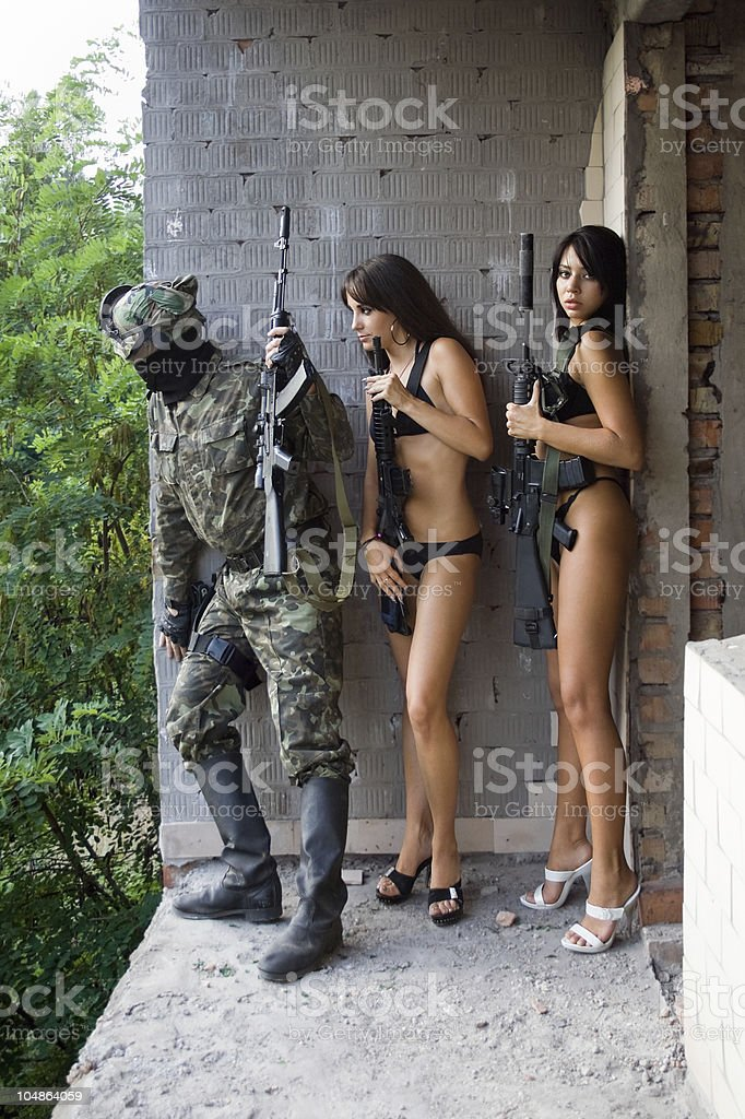 soldier and two women stock photo